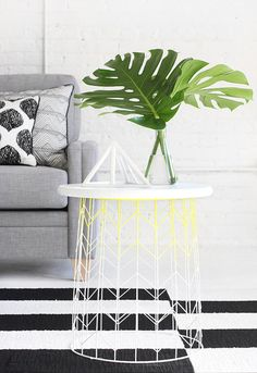 Paint a wire basket and flip it over for a modern accent table.