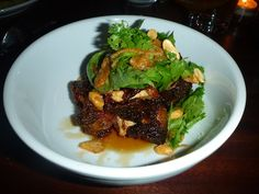 Spicy twice cooked oxtails -  with lots of herbs, peanuts & fried shallots