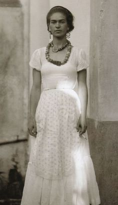 the clothes, the styling, the posture, the cig, the confidence ... and it's also a pretty picture of Frida Kahlo