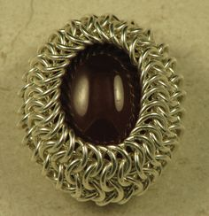 how to wrap a cabochon in chain maille.  #wire #jewellry #tutorial