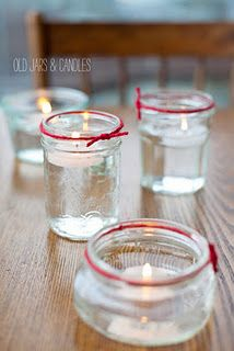 Old glass jars for candles with a touch of colour - very effective on white linens