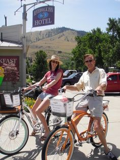 A happy couple Merving around Lake Chelan on a pair of Pedego Electric bikes.www.chelanelectricbikes.com