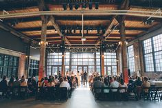 The bride and groom chose to wed in Toronto's Steam Whistle Brewery, which is the perfect setting for its rustic charm, yet have it chic. See gallery here.