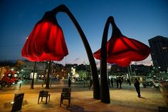Giant flowered street lamps that bloom whenever people stand underneath them | Creative Boom