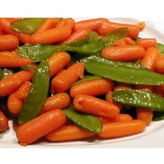 """Honey Glazed Pea Pods and Carrots     """"A touch of golden honey flavors these tender pea pods mixed with sweet carrots."""" - Michele O'Sullivan"""