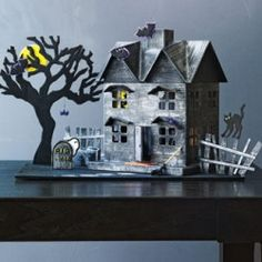 Project: Haunted House House repairs needed? Create this fun papier-mache haunted house before the spooks begin.House repairs needed? Create this fun papier-mache haunted house before the spooks begin. Casa Halloween, Theme Halloween, Easy Halloween Crafts, Easy Halloween Decorations, Halloween Village, Halloween Haunted Houses, Halloween Projects, Holidays Halloween, Craft Projects