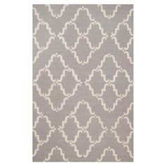 A ribbon trellis print elevates this hand-looped wool rug with a touch of elegance. It'll look stylish in the dining room, or makes the perfect finishing tou...
