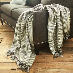 Arhaus.  $139 throw. Classic navy and neutral tones. Our Banks navy stripe wool pillow and throw are made of soft 100% wool. Bring a warm touch and soothing texture to an