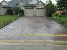 Rough Cut Stone Stamped Concrete Driveway with Stone Block Border in Delaware Ontario Stamped Concrete Driveway, Concrete Driveways, Stone Blocks, Driveway Ideas, Rough Cut, Delaware, Ontario, Sidewalk, Decor