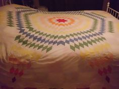 Vintage Lone Star Starburst Handsewn Quilt Top  Mid Century Bright Colors  Supplies. $34.00, via Etsy.