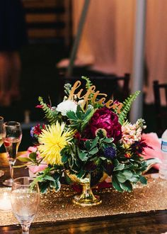 Colorful centerpiece // See more: http://theeld.com/1ydsPeD