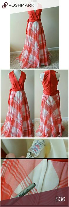 Vintage 1970s  Red Gigham Checker Print Maxi Dress This dress is TRULY STUNNING! The plaid print and red top portion make this dress really pop without being over the top.   It is truly a LONG maxi.  Perfect for outdoor family photo shoot, picnick, brunch, country or beach wedding guest attire, cruise dress...I could go on forever.    Zips up back. Clasp neck closure.   One sided tie, wraps around and knots.   Measurements:  Bust: 38 Waist: 28 Hips: free flowing Length of skirt portion:45…
