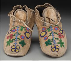 A Pair of Northern Plains Beaded Hide Moccasins