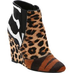 Christian Dior Tiger And Leopard Print Calf Hair 'delta' Wedge Ankle... ($1,115) ❤ liked on Polyvore featuring shoes, boots, ankle booties, wedge heel boots, sport boots, side zip boots, leopard print boots and calf hair boots