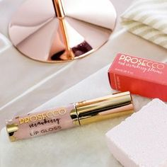 Prosecco And Strawberry Flavoured Lip Gloss In Nude. Discover thoughtful, personal and wonderfully unique gifts for her this Christmas.