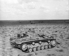 An Afrika Corp Panzer 3 is sitting damaged in the vast desert Afrika Corps, North African Campaign, Erwin Rommel, Work Horses, Ww2 Tanks, History Class, Historical Photos, World War Ii, Tanks