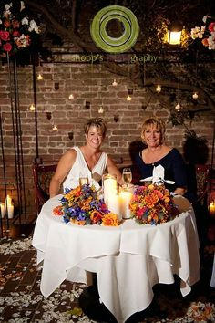 Vibrant Orange & Blue wedding color palette at The Firehouse Restaurant in Old Sacramento. Floral design and bouquets by Visual Impact Design. Shoop's Photography.