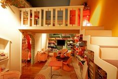 love this playroom with #loft lots of toy storage and pretty colors!! love that table and chairs set too!