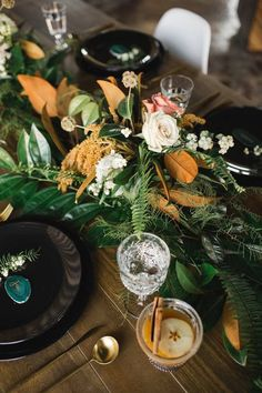 Greenery wedding centerpiece for winter - centerpiece with greenery, leaves and white roses - Find a florist in your city on WeddingWire! {Solstice Floral Studio}