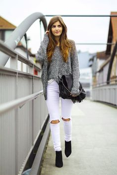 grey cable knit sweater + white ripped jeans street style idea