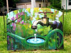 Garden mural on fence boards.
