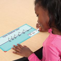 Using an open number line -- laminate and use expo.  Good math center idea.