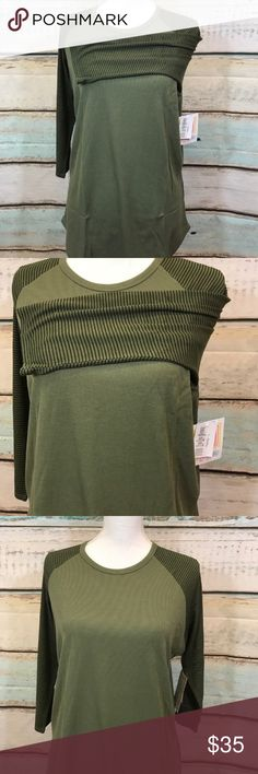 LuLaRoe Randy Tee size Large Nwt. LuLaRoe Randy Tee size Large Nwt. Heavier feel to this shirt.  Perfect for fall. 🍀price is firm unless bundled LuLaRoe Tops