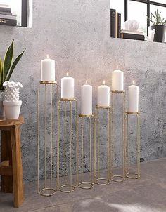 Home affair candle holder for 6 candles Golden home accessories are a real furnishing trend that brings glamor to your …