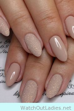 Soft nude stiletto nail with glitter