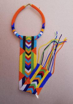 This necklace is 100% handcrafted using Orange and multicolor beads. Perfect for African themed events, weddings, traditional events etc. The necklace makes a good gift. Measurements; Rope: 18 long Pendant: 18 long. **Buy multiple items and pay shipping for 1 item only.The rest ships free. Diy African Jewelry, African Bracelets, African Accessories, African Necklace, African Beads, Fashion Accessories, Long Pendant Necklace, Beaded Necklace, Fringe Necklace