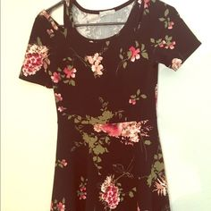 Floral cold shoulder mini flare dress So cute. Really trendy pink and black cold shoulder mini flare dress. Very sexy. I love this dress! Dresses Mini