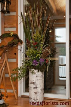 Catails, grasses, ornamental cabbages, broom corn and fern in a birch bark container echo the forest setting of this rustic lodge wedding. Fresh Flowers, Beautiful Flowers, Broom Corn, Ornamental Cabbage, Cabbages, Lodge Wedding, Birch Bark, Grasses, Fern