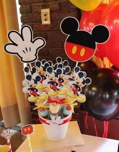 Candy pops at a Mickey Mouse baptism party! See more party ideas at CatchMyParty.com!