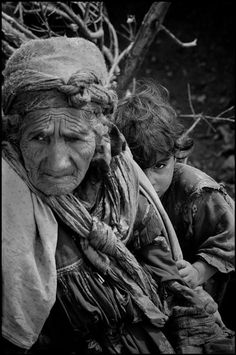 by Philip Jones Griffiths - ALGERIA. 1962. The War in Algeria. Grandmother and child in a regroupment camp in the Kabylie region Magnum Photos Photographer Portfolio