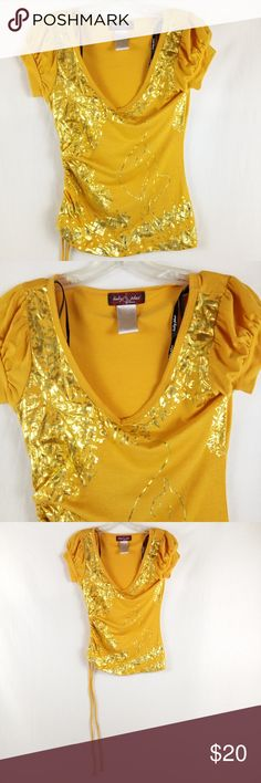 "Baby Phat Blouse Size S Orange Gold Short Sleeve Clean excellent condition.  MEASUREMENTS:  CHEST/BUST: 15.5""   SLEEVE: 4""  LENGTH: 21""  We do our best to maintain quality standards during inspection before listing items for sale in our closet, so you are happy to open your Poshmark package from Shebrew Trading Store!  We ship items immediately and maintain a high satisfaction rating. Thank you! Baby Phat Tops Blouses"