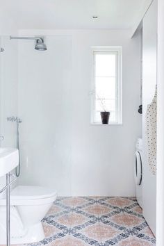 A Gallery of Luxuriously Minimal Bathrooms YES YES YES no border shower and easy to spray down toilet for cleaning... my dream...