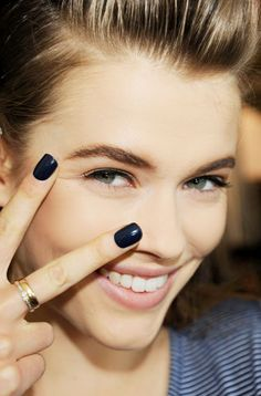 Backstage manicurists threw their support behind classic shades of rich burgundy and midnight blue that picked up on the strong, feminine attitude of the collections. Keep your nails short and square with rounded corners and apply two generous layers of lacquer finished with a glossy top coat for a take-charge effect.