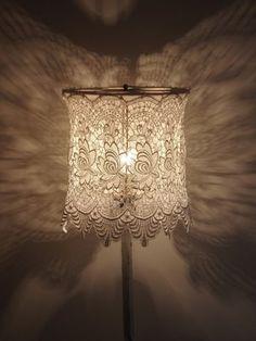 valon paloa: pitsivarjostimia  Lace over a lamp shade base.