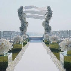 No ordinary floral-canopy, the curved shape of this structure, composed of hundreds of white orchids and roses, truly gave the appearance that it was moving with the light breeze. WedLuxe Magazine
