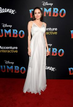 Angelina Jolie Stuns at 'Dumbo' Premiere with Her Kids!: Photo Angelina Jolie looks gorgeous while stepping out on the red carpet with four of her six kids at the Dumbo premiere on Monday (March at the El Capitan Theatre… Kung Fu Panda 3, Isabelle Huppert, A Line Evening Dress, Long Evening Gowns, White Chiffon, Silk Chiffon, Brad Pitt, Chris Hemsworth, Angelina Jolie Photos
