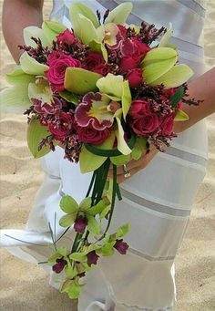 Tropical Cascade Bridal Bouquet: Magenta Roses, Lime Green Cymbidium Orchids, Lime/Fuchsia Orchids, Green Lily Grass
