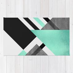 Buy Area & Throw Rugs with design featuring Foldings by Elisabeth Fredriksson and adorn your home with both style and comfort. Available in three sizes (2' x 3', 3' x 5', 4' x 6').