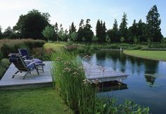 ahhh, peaceful. cantilevered deck in a garden designed by Acres Wild, in Buriton, Hampshire, England