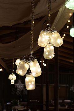 hung mason jar lights for country rustic barn wedding idea