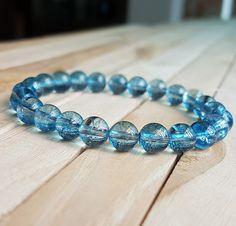 Check out this item in my Etsy shop https://www.etsy.com/listing/496263775/810mm-blue-stone-bracelet-blue-phantom