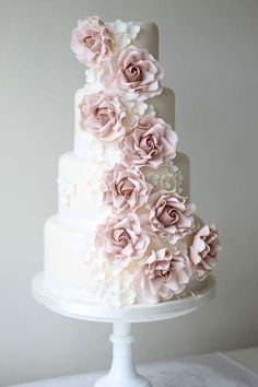 Chic wedding cake idea with pink floral details. Cake: Ivory & Rose Cake Company