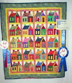 I love house quilts.  Like the quilter's use of prints and bright colored fabrics.  Again this quilt was at eh Long Island Quilters Society Quilt Show.