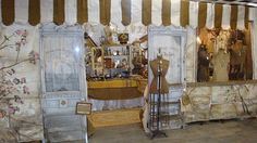 This is a booth decorated to look like a store on a street. The artist behind it painted on tarps -read this post to see Craft Fair Displays, Market Displays, Display Ideas, Booth Ideas, Craft Booths, Booth Displays, Creative Connections, Craft Stalls, Jewelry Wall