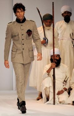 An Indian model present a creation by designer Himmat Singh during the Van Huesen India Men's Fashion Week