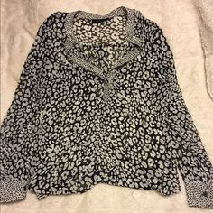 Sheer leopard print top ANA Leopard print. No snags or holes in excellent condition. V-neck with a couple buttons. a.n.a Tops Blouses